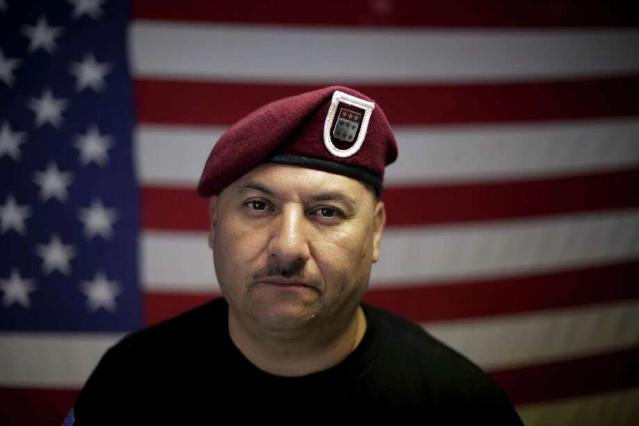 """In this Feb. 13, 2017 photo, U.S. Army veteran Hector Barajas, who was deported, poses for a portrait in his office at the Deported Veterans Support House, nicknamed """"the bunker"""" in Tijuana, Mexico. Despite the pain of separation, many deported vets say they wouldn't hesitate to serve again if given the chance. """"Where do I sign up?"""" said Barajas. (AP Photo/Gregory Bull) Photo: Gregory Bull, STF / Associated Press / Copyright 2017 The Associated Press. All rights reserved."""