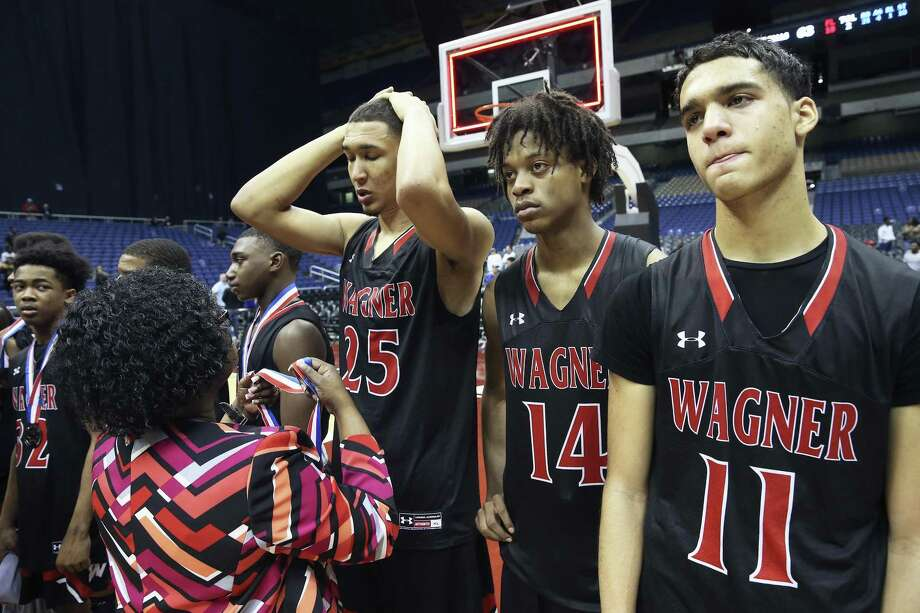 Tristan Clark receives his medal after Wagner loses to the Cypress Falls Eagles in the state championship basketball game for class 6A boys at the Alamodome on March 11, 2017. Photo: Tom Reel, Staff / San Antonio Express-News / 2017 SAN ANTONIO EXPRESS-NEWS
