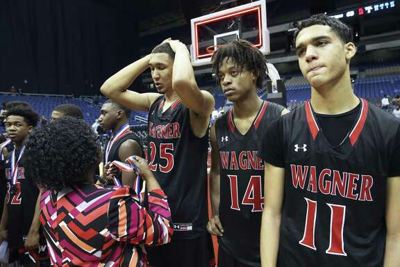 Tristan Clark receives his medal after Wagner loses to the Cypress Falls Eagles in the state championship basketball game for class 6A boys at the Alamodome on March 11, 2017.