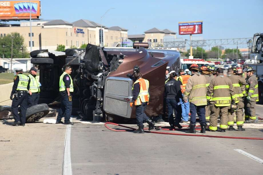 Police and emergency personnel are responding to a rollover crash involving an 18-wheeler on March 14, 2017, near West Avenue on Interstate 10. Photo: Caleb Downs
