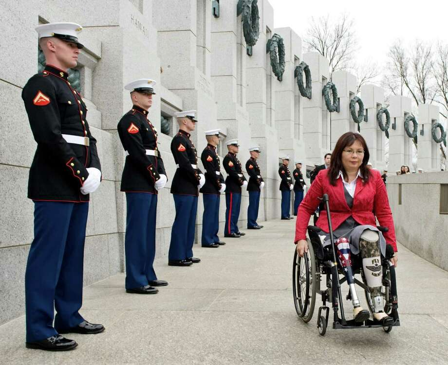 FILE - In this Thursday, March 11, 2010 file photo, Tammy Duckworth, assistant secretary for the U.S. Department of Veterans Affairs, arrives at the World War II Memorial in Washington for a ceremony honoring World War II veterans who fought in the Pacific. Duckworth, who is running in 2012 as a congressional candidate in Illinois, became a double amputee when her National Guard helicopter was shot down in Iraq in 2004. During the long wars in Afghanistan and Iraq, hundreds of thousands of veterans have come home and laid aside their uniforms. But not all have opted to simply blend back into civilian life. Many have chosen to run for public office. (AP Photo/Cliff Owen) Photo: Cliff Owen, FRE / Associated Press / FR170079 AP