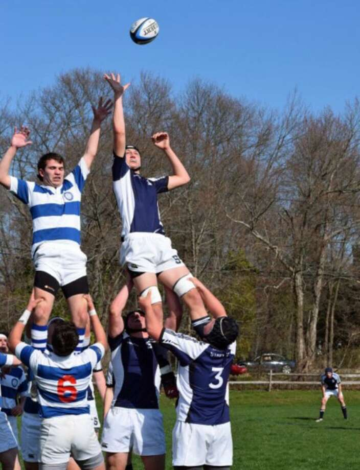 Action from the Staples rugby team's 54-5 win over Darien on Friday. Photo: Contributed Photo / Westport News Contributed