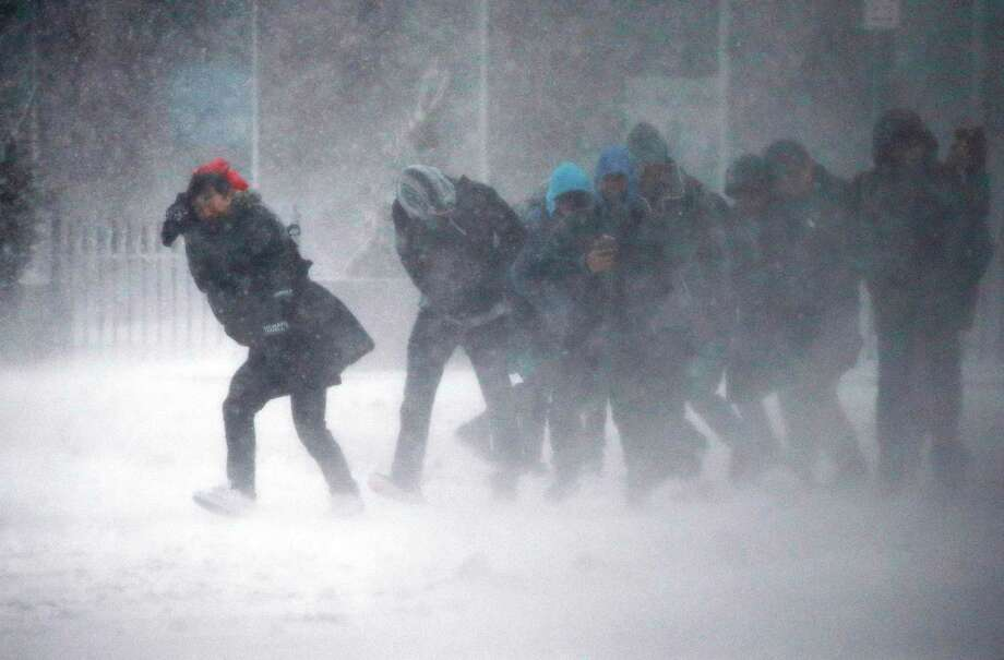 People struggle to walk in the blowing snow during a winter storm Tuesday, March 14, 2017, in Boston. Photo: Michael Dwyer, AP / Copyright 2017 The Associated Press. All rights reserved.