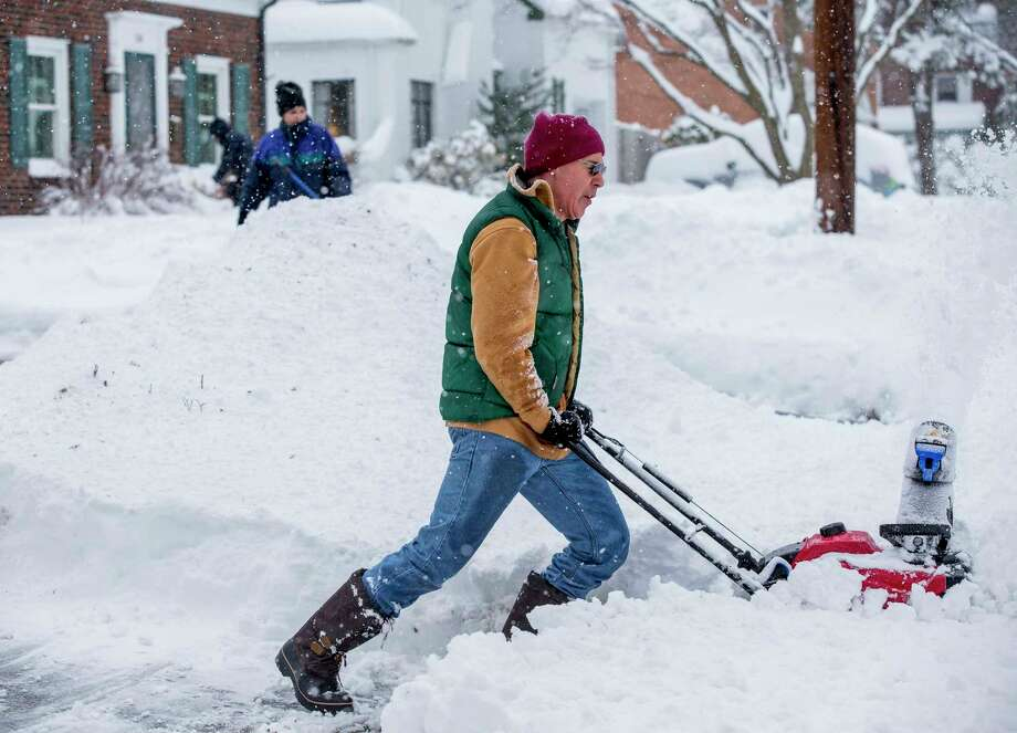 David Watts, Camp Hill, plows his sidewalk and driveway after winter storm Stella dumped over a foot of snow Tuesday, March 14, 2017. The powerful nor'easter grounded nearly 6,000 flights, knocked out power to over 180,000 customers from Virginia northward, closed schools in cities big and small and prompted dire warnings to stay off the roads. Amtrak suspended service and the post office halted mail delivery.  (Mark Pynes /PennLive.com via AP) Photo: Mark Pynes, AP / PA_Media_Group