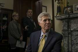 FILE � Judge Neil Gorsuch meets with Sen. David Purdue (R-Ga.) in his office on Capitol Hill in Washington, Feb. 10, 2017. Senate Judiciary Committee hearings on Gorsuch�s nomination to the Supreme Court are scheduled to begin on March 20, more than a full year after the death of Justice Antonin Scalia. (Gabriella Demczuk/The New York Times)