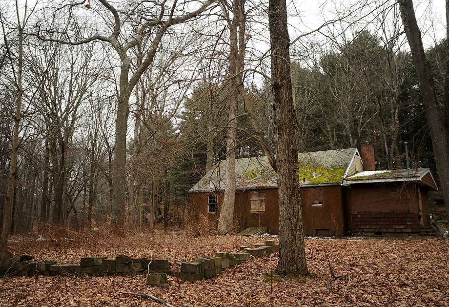 The site of the boarded up ranger's cabin in Roosevelt Forest in Stratford, Conn. is being considered as a possible location for the town's new dog park on Sunday, February 5, 2017. Photo: Brian A. Pounds / Hearst Connecticut Media / Connecticut Post