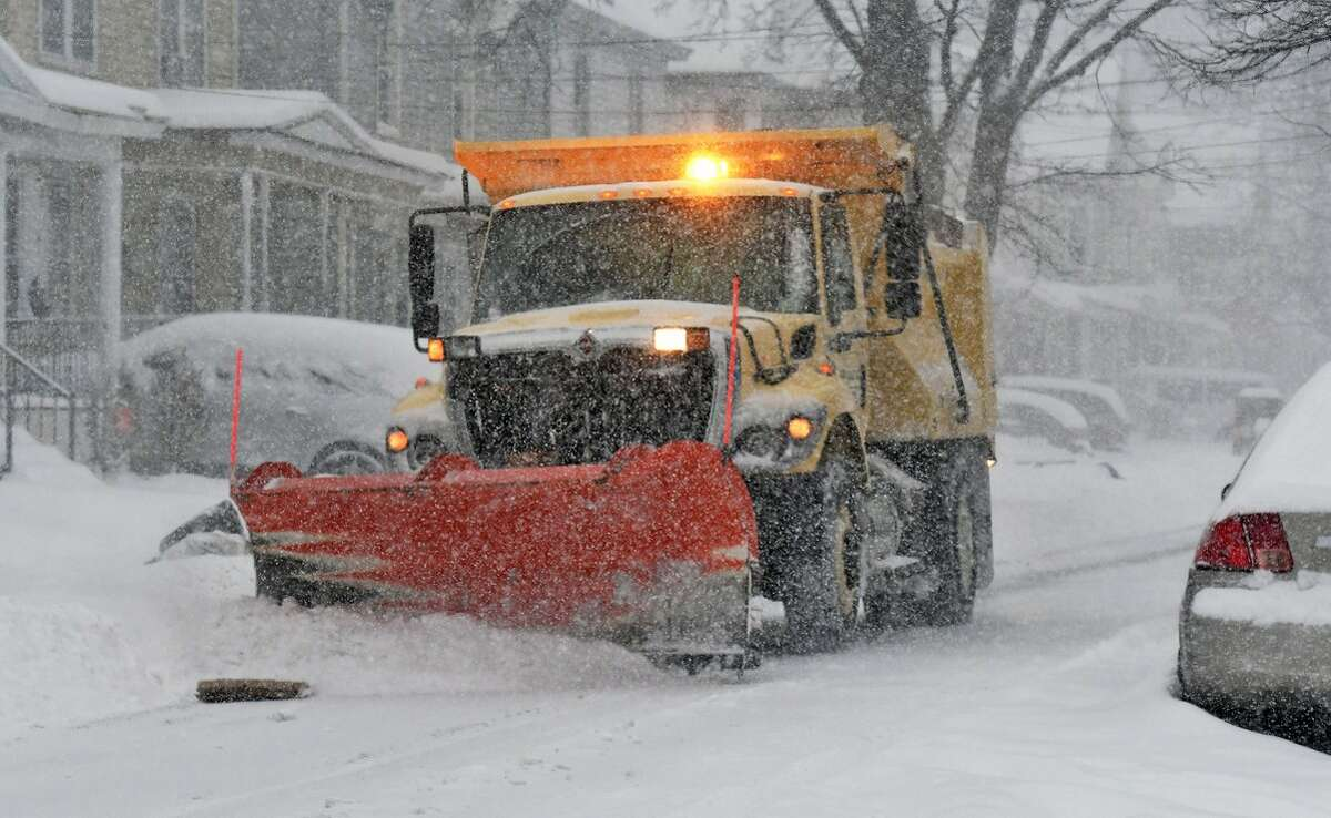 A snow plow tries to stay ahead of the drifts on Tuesday, March 14, 2017. (John Carl D'Annibale/Times Union)