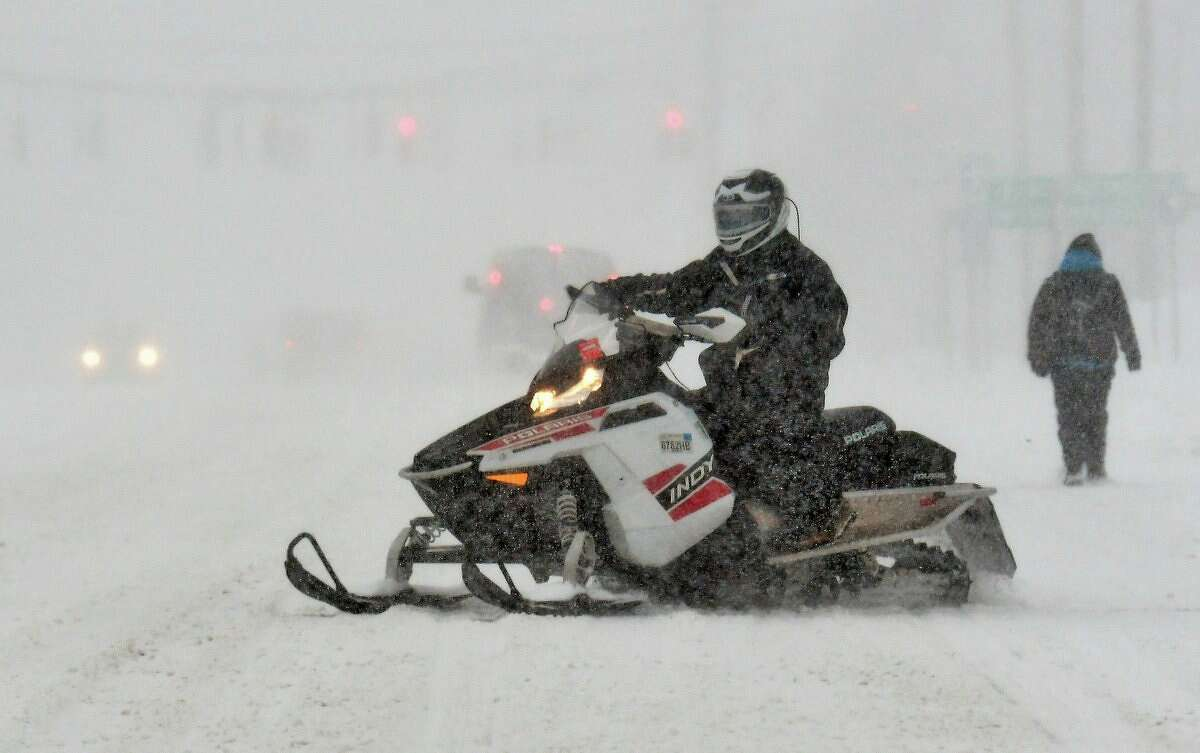 A snowmobile makes it way down Central Avenue on Tuesday, March 14, 2017. (John Carl D'Annibale/Times Union)