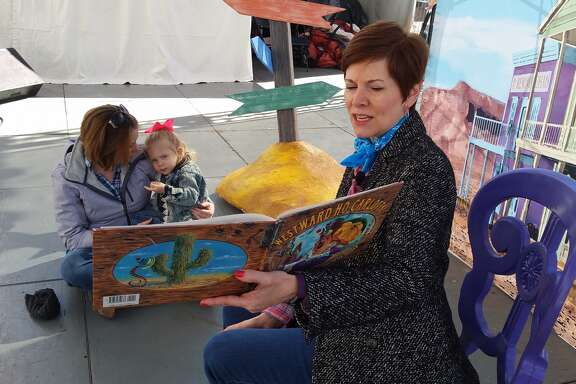 Opera singer Sandra Campbell sings a children's story Tuesday morning at RodeoHouston for an audience of one: 2-year-old Kodie Belle Laborde.