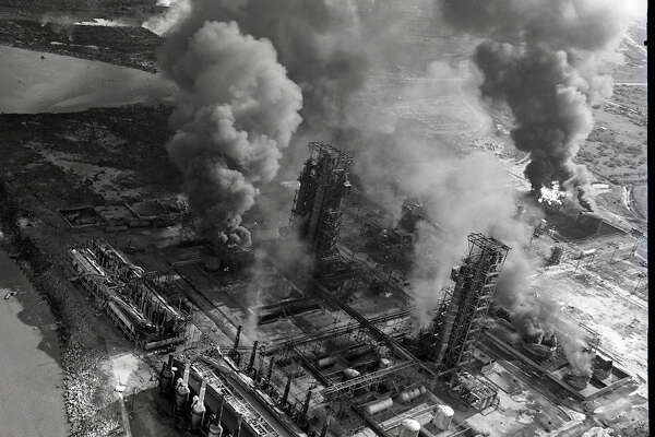 A burning plant is seen from the air after the Texas City disaster in 1947. Photographer Rolfe Christopher said flying over the disaster was more harrowing than his time in the Pacific during World War II, due to the smoke and crowd of airplanes, according to his son, Gary.  Photo from Lamar University Archives and Special Collections