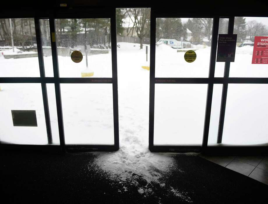 The automatic doors are stuck with snow at CVS in the Cos Cob section of Greenwich, Conn. Tuesday, March 14, 2017. A winter storm warning is in effect until midnight, with near blizzard conditions and 4 to 14 inches of snow expected in the area. Photo: Tyler Sizemore, Hearst Connecticut Media / Greenwich Time