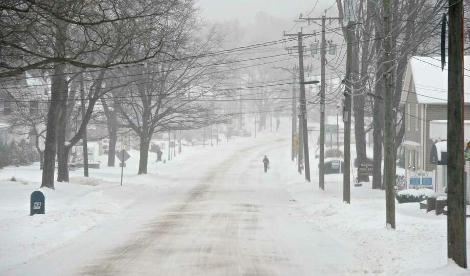 A man walks on Greenwood Avenue, in Bethel, Conn, during Winter Storm Stella,Tuesday afternoon, March, 14, 2017. Photo: H John Voorhees III, Hearst Connecticut Media / The News-Times