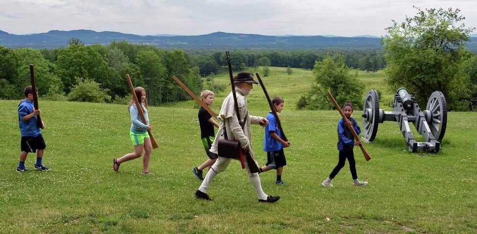 Park Ranger Joe Craig, in Colonial garb, drills Broadalbin-Perth fourth graders in