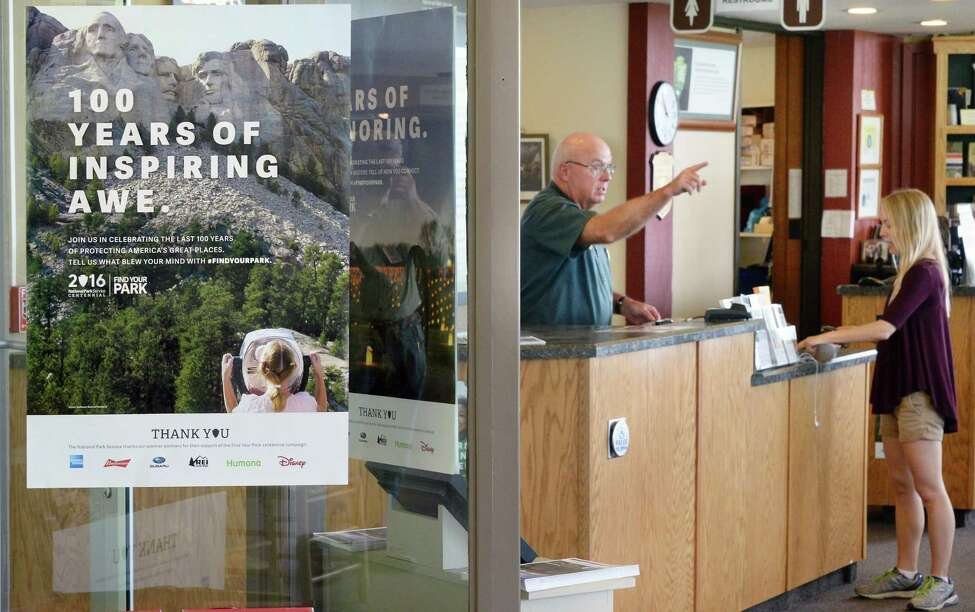 Volunteer Jim Kearney directs a park goer at the fee desk in the visitors center at Saratoga National Historical Park on Thursday, June 16, 2016, in Stillwater, N.Y. (John Carl D'Annibale / Times Union)