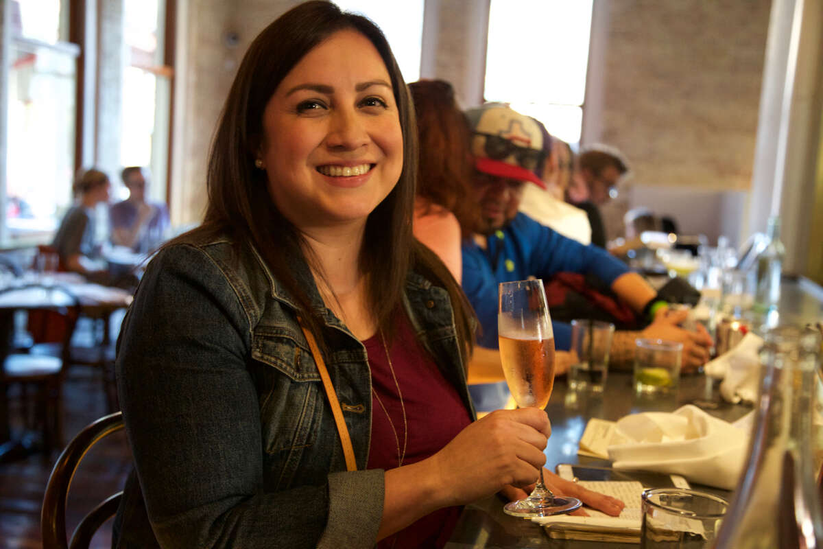 Christina Liserio enjoys a drink at Cured.