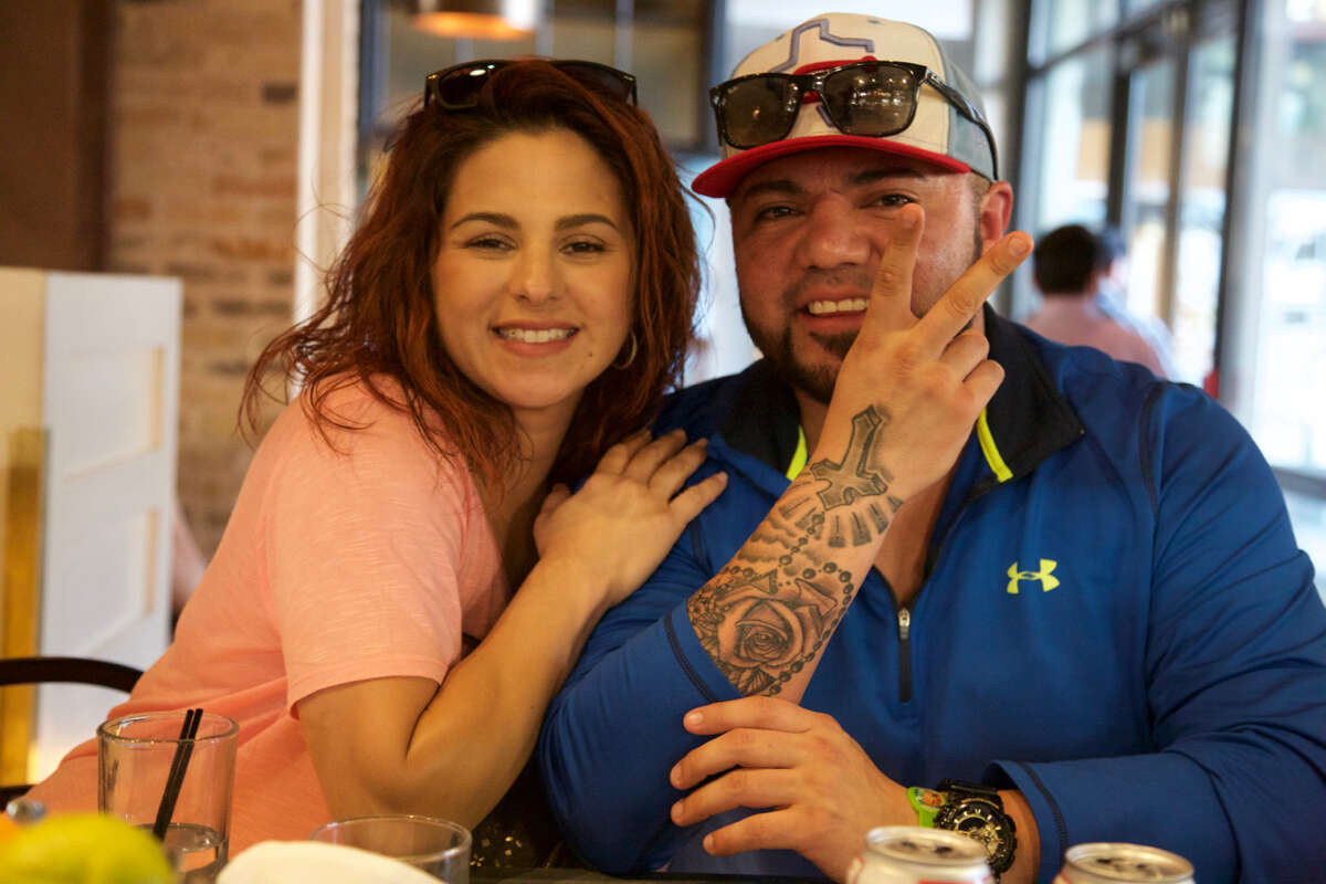 Sheena Perez and Brian Garcia have a good time at Cured.