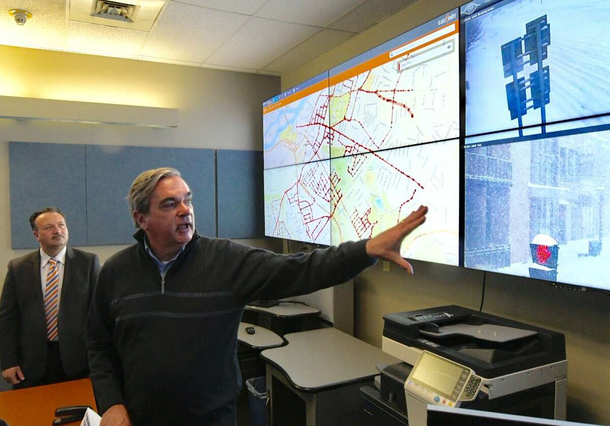 Schenectady Mayor McCarthy and Transfinder CEO Antonio Civitella, background, demonstrate new locating software from Transfinder that Schenectady plow crews used to remove snow from city streets on Tuesday. (Skip Dickstein / Times Union)
