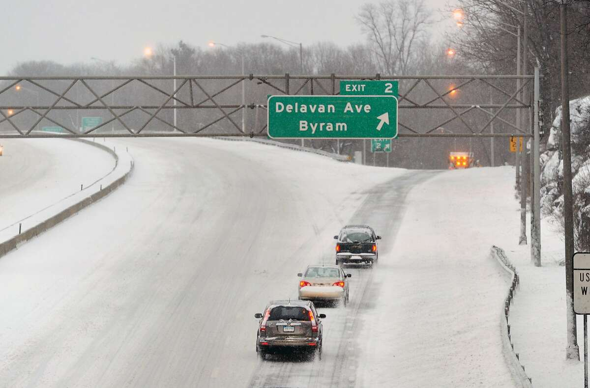 Vehicles head north on I-95 near exit 2 in Byram during the snowstorm that hit Greenwich, Conn., Tuesday, March 14, 2017. Meteorologists are predicting a mixtured of snow and sleet with a steady wind of between 20-30 mph with an accumulation of snow of less than a foot for Greenwich and the surrounding area once the storm ends tonight.