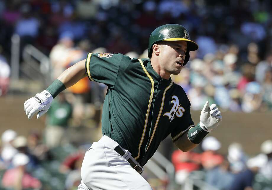 Oakland Athletics' Jake Smolinski runs after hitting an RBI double during the second inning of a spring training baseball game against the Arizona Diamondbacks, Tuesday, March 7, 2017, in Scottsdale, Ariz. (AP Photo/Darron Cummings) Photo: Darron Cummings, Associated Press