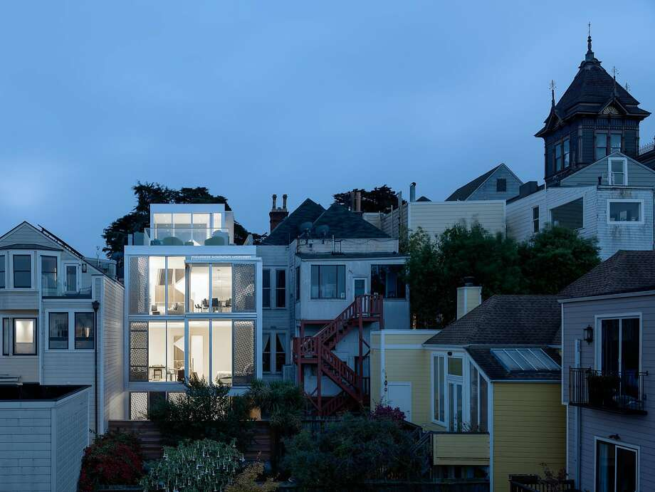1164 Fulton St., second from left, overlooks the north side of Alamo Square Park. Photo: Aaron Leit