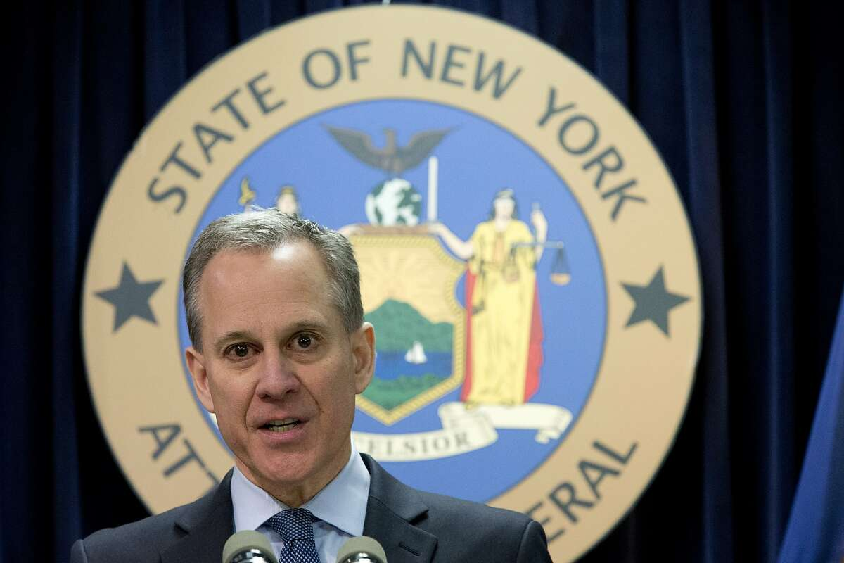 FILE - In this Feb. 11, 2016, file photo, New York Attorney General Eric T. Schneiderman speaks during a news conference in New York. Schneiderman says that while Secretary of State Rex Tillerson was CEO of Exxon he used an alias in emails to talk about climate change. Schneiderman made the accusation in a letter to a New York court Monday, March 13, 2017. He is investigating whether the company deceived investors and the public by hiding for decades what it knew about the link between fossil fuels and climate change. (AP Photo/Mary Altaffer, File)