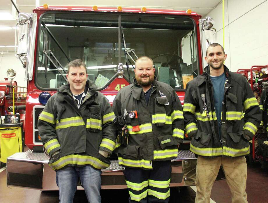 Darien firefighters Shane Smith, left, James Townsend and Alex Orsi will be shaving their heads to raise money for childhood cancer. Photo: Erin Kayata / Hearst Connecticut Media / Darien News