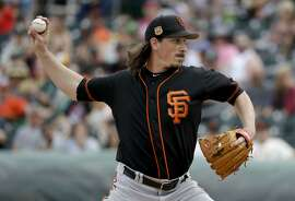 San Francisco Giants starting pitcher Jeff Samardzija throws against the Oakland Athletics during the first inning of a spring training baseball game in Mesa, Ariz., Friday, March 3, 2017. (AP Photo/Chris Carlson)