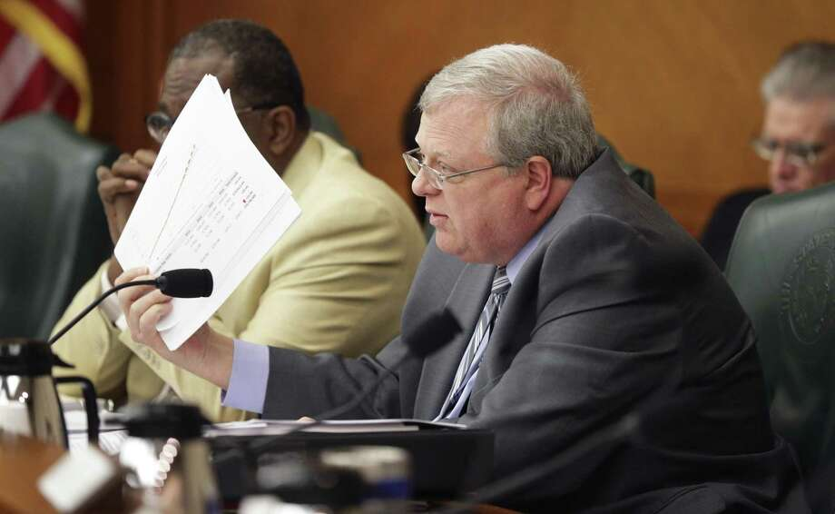 Senator Paul Bettencourt flashes reports with numbers as he makes his case for the bill as the Senate Finance Committee holds a hearing in the State Capitol concerning SB 2 the legislation designed to put restrictions on local property tax revenue on March 14, 2017. Photo: Tom Reel, Staff / San Antonio Express-News / 2017 SAN ANTONIO EXPRESS-NEWS