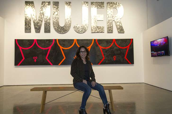 """Carla Veliz with the pieces she contributed to """"A Woman's Place ..."""" at Centro de Artes."""