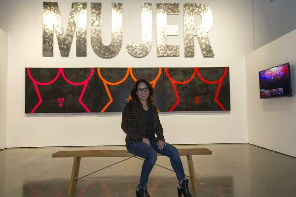 """b25bb66d2a50c 1of8Carla Veliz with the pieces she contributed to """"A Woman s Place ..."""" at  Centro de Artes.Photo  Alma E. Hernandez   For the San Antonio Express News"""