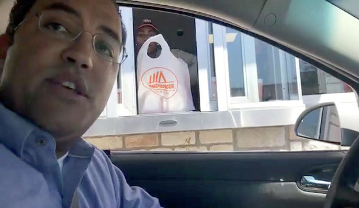 """Rep. Will Hurd, a Republican who represents Southwest Texas, stops a What-a-Burger in Waco. He and Rep. Beto O'Rourke, a Democrat from El Paso, are live streaming online while on a ?""""bipartisan roadtrip town hall?• while driving from San Antonio to Washington, D.C., after a blizzard affected travel plans"""