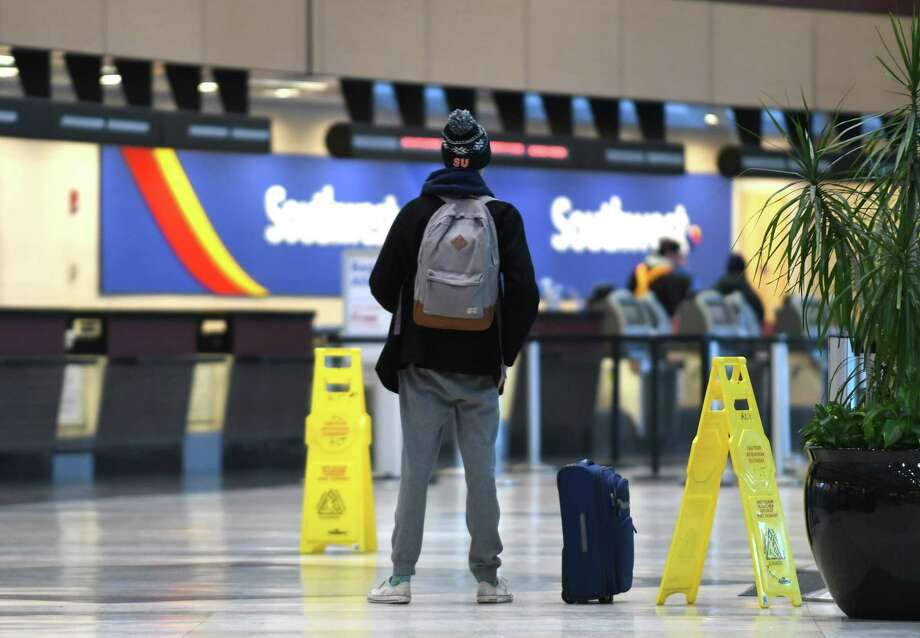Canceled flights at Albany International Airport left some travelers stranded as a heavy snowstorm swept through the Capital Region on Tuesday, March 14, 2017, in Colonie N.Y. All flights in and out of Albany were canceled. Only the main runway was kept open the arrival of diverted national and international flights, in-flight emergencies and medical emergencies. (Will Waldron/Times Union) Photo: Will Waldron / 20039949A