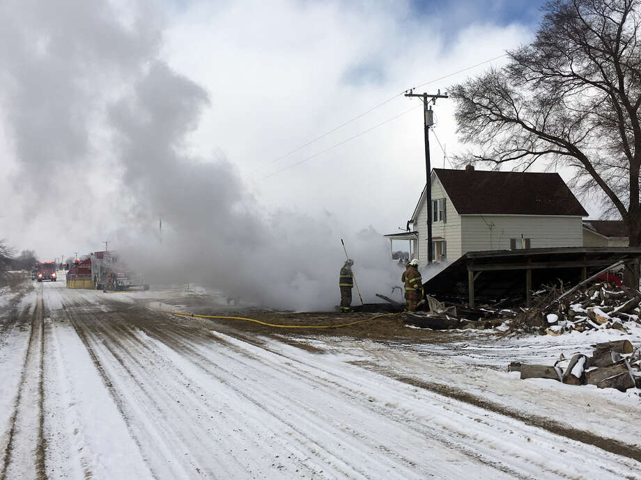 Firefighters work at the scene of the fire Tuesday. Photo: Coulter Mitchell/For The Tribune