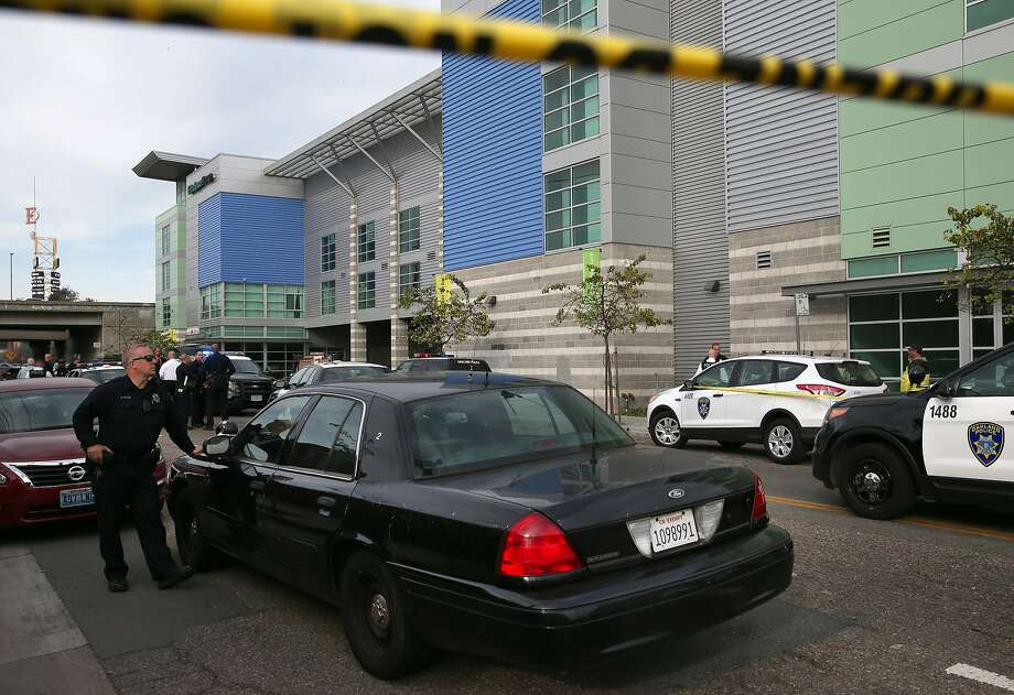 Police officers from Oakland and Emeryville investigate an officer-involved shooting of Yuvette Henderson on Hollis Street near 34th Street in Oakland, Calif. on Tuesday, Feb. 2, 2015. According to authorities, police officers from Emeryville pursued Henderson on their side of the border and reportedly shot and killed her in the city of Oakland. Police say she was armed with a weapon. But a federal magistrate ruled on Monday, March 13, 2017, that a suit by Henderson's children would not be dismissed because a jury could find that she posed no threat to the officer who shot her as she lay wounded on the ground. Photo: Paul Chinn, The Chronicle