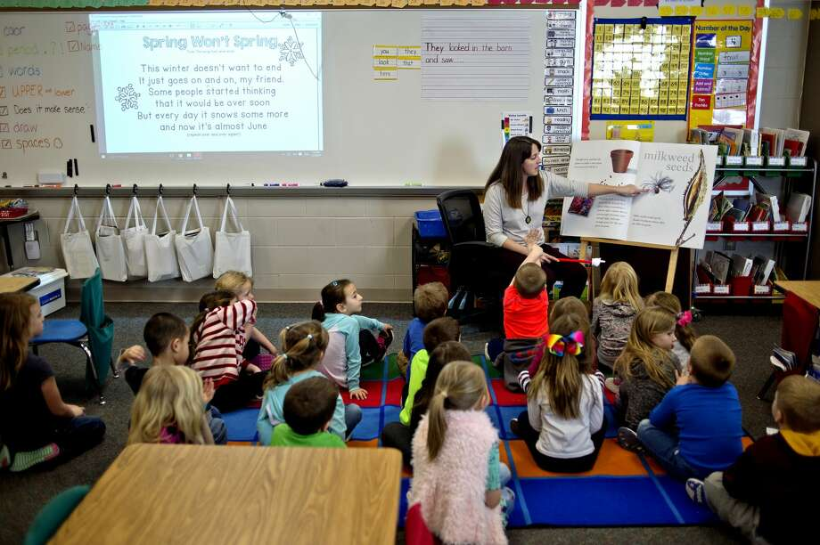 Coleman Elementary kindergarten teacher Rachel Brownlee reads to her students about plant seeds as part of the AgKindergarten program on Monday in Coleman. The program provides students an understanding of Agriculture and other STEM skills at a young age. An $8000 grant through the Community Foundation Dow Corning Funding helped get the program off the ground. Photo: Nick King/Midland Daily News