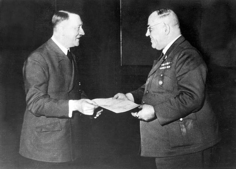 Adolf Hitler awards his personal physician, Theodor Morell, with the Knight's Cross of the War Merit Cross in 1944. Photo: Heinrich Hoffmann / Ullstein Bild Via Getty Images