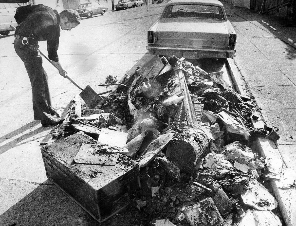 Police detectives search throughout the rubble from the house at 1301 Kansas Street in San Francisco was set on fire by Angelo Pavageau after he murdered Frank Carlson, and brutally beat and raped Carlson's wife Photo ran 04/20/1974, P. 14
