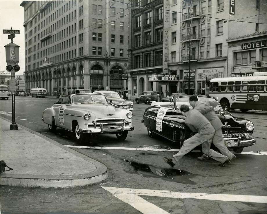 "A safety driving test was performed in San Francisco, on Market Street at Drumm Street. The light car was driven by the ""considerate"" driver, the dark one by the ""inconsiderate"" driver. August 10, 1950 Photo: Bob Campbell, San Francisco Chronicle"
