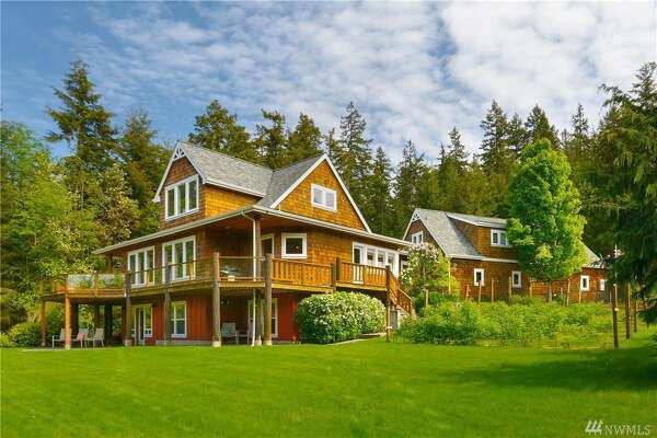 Reminiscent of a secluded mountain lodge, this spacious home sits on 2.3 acres with an Olympic Mountain view and expansive deck and patio. Next to Whitehorse Golf & Heritage Park with miles of trails, the home includes room for a home office, studio space, and guests.  