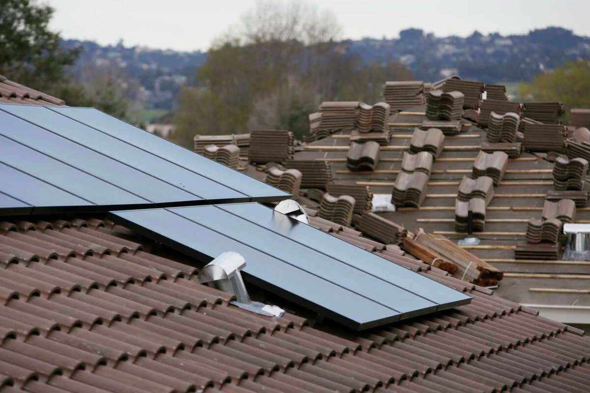 SunPower solar panels are seen installed on a new home being built at a Mertiage Home's community called Kingston Square on Friday, January 6, 2017 in Hayward, Calif.