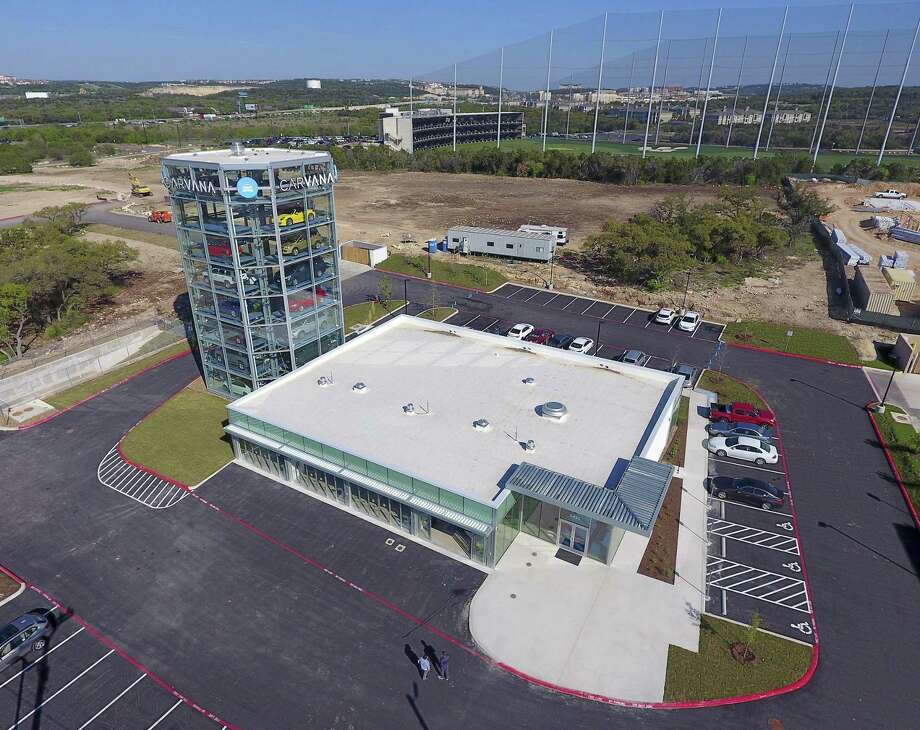 "Carvana's ""car vending machine,"" which consists of a tower that can hold up to 30 used vehicles at a site near Interstate 10 and Loop 1604. Online customers who have bought a vehicle can come pick up their car in person at this facility. Photo: William Luther /San Antonio Express-News / © 2017 San Antonio Express-News"