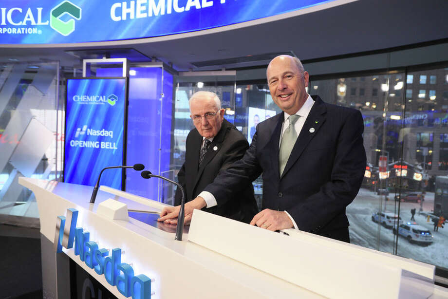 Chemical Bank President and CEO David Ramaker, right, and former president and CEO Alan Ott as they ring the bell for the opening of Nasdaq on Tuesday. The bank celebrated its 100th anniversary on Tuesday. / 2017 Christopher Galluzzo / Nasdaq, Inc.