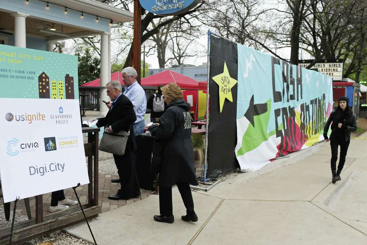 Attendees arrive at the Choose San Antonio's event during South by Southwest Conference and Festival in Austin, Sunday, March 12, 2017. The nonprofit turned the Half Step Bar on Rainey Street into Casa San Antonio in an effort to lure hipsters and techies to San Antonio.