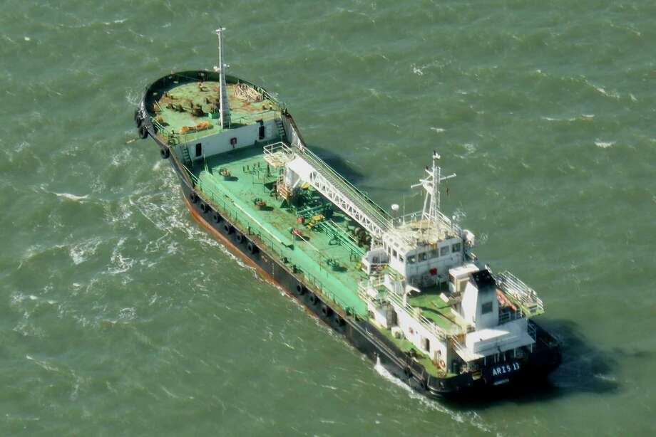In this photo taken Monday, Oct. 27, 2014, the Aris 13 oil tanker is seen from a helicopter in the harbor of Gladstone, Australia. Pirates have hijacked the Aris 13 oil tanker off the coast of Somalia, officials and piracy experts said Tuesday, March 14, 2017, the first such seizure of a large commercial vessel on the crucial global trade route since 2012. (Kevin Finnigan/Tropic Maritime Images via AP) Photo: Kevin Finnigan, UGC / Tropic Maritime Images