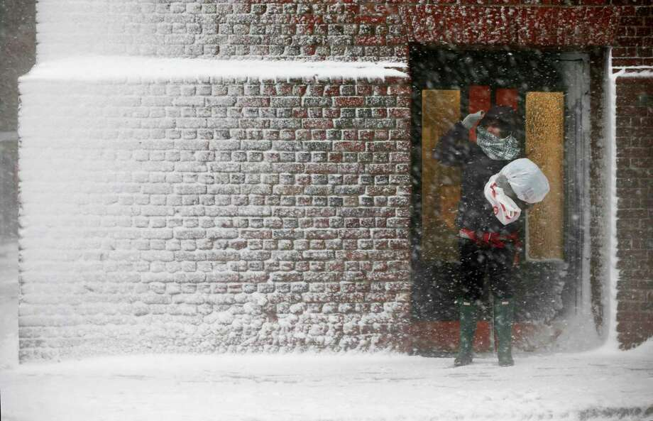 A person stands in the wind-driven snow during a winter storm Tuesday, March 14, 2017, in Boston. (AP Photo/Michael Dwyer) Photo: Michael Dwyer, STF / Copyright 2017 The Associated Press. All rights reserved.