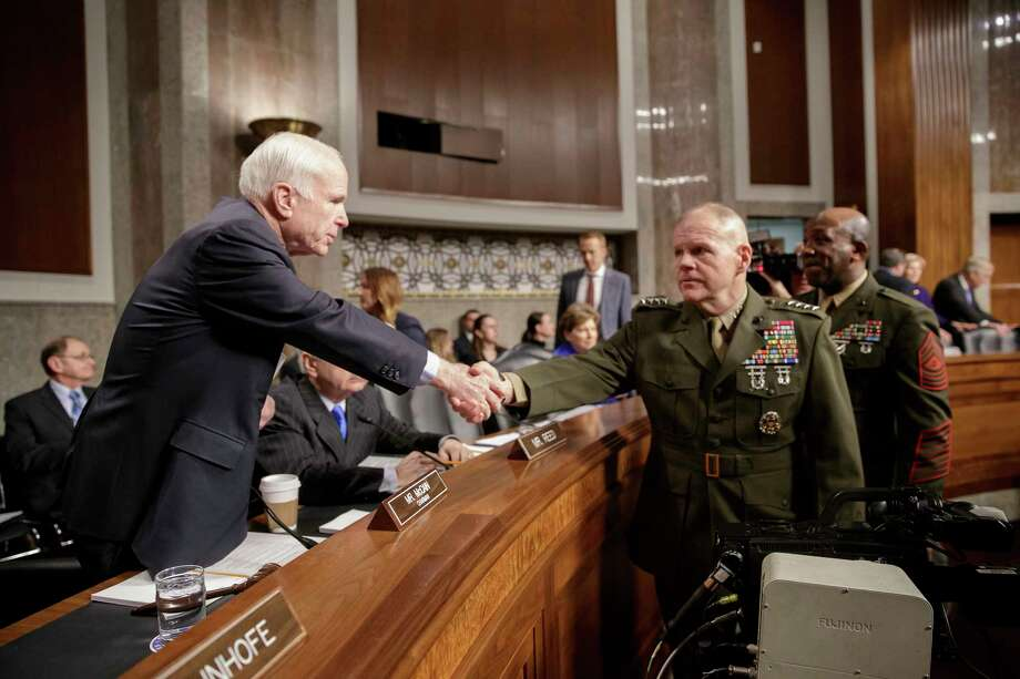 """Senate Armed Services Committee Chairman Sen. John McCain, R-Ariz., left, welcomes Marine Corps Commandant Gen. Robert B. Neller, center, and Sgt. Major of the Marine Corps Ronald L. Green on Capitol Hill in Washington, Tuesday, March, 14, 2017, prior to the start of the committee's hearing on the investigation of nude photographs of female Marines and other women that were shared on the Facebook page """"Marines United.""""  (AP Photo/J. Scott Applewhite) Photo: J. Scott Applewhite, STF / AP"""