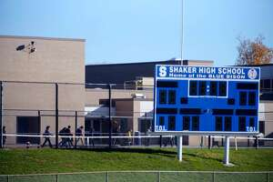 """Students prepare to enter Shaker High School Monday after classes were delayed by the discovery of a """"suspicious"""" package near the entrance to the school. (Paul Buckowski / Times Union)"""