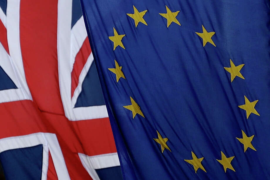 A European and British Union flags hang outside Europe House, the European Parliament's British offices, in London, Tuesday, March 14, 2017. (AP Photo/Matt Dunham) Photo: Matt Dunham, STF / Copyright 2017 The Associated Press. All rights reserved.
