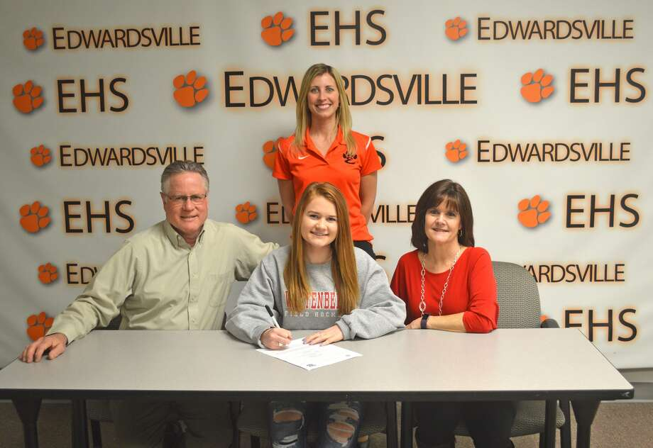 Edwardsville senior Veronica Carrow will play field hockey for Wittenberg University. In the front from left to right are father John Carrow, Veronica Carrow and mother Dana Carrow. EHS coach Julia Tyler is in the back row.