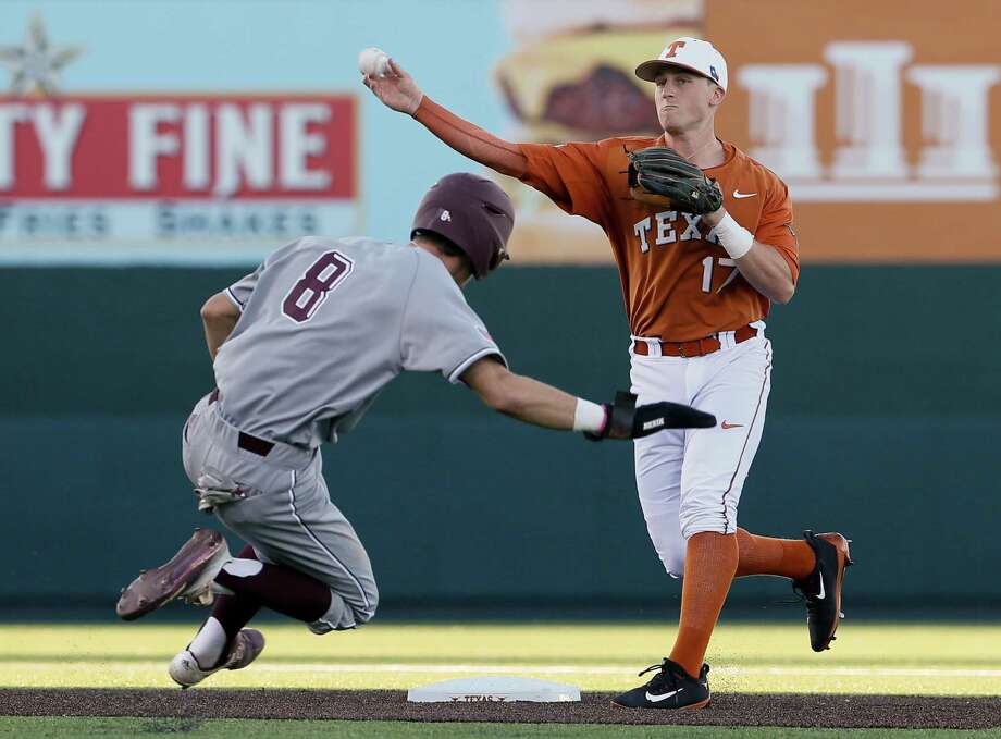Bret Boswell take relay throw for a double play in a game of the Texas A&M University versus the University of Texas at UFCU Disch-Falk Field in Austin, Texas on March 14, 2017 Photo: Andy Nietupski, Andy Nietupski For AMERICAN STATESMAN / Andy Nietupski